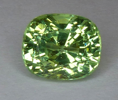 green grossular garnet - glows pink under UV light