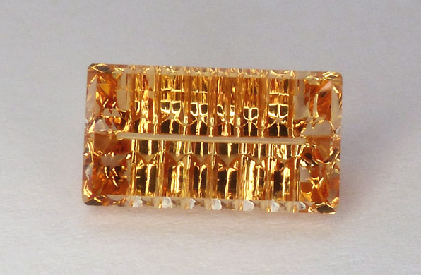 concave faceted imperial topaz
