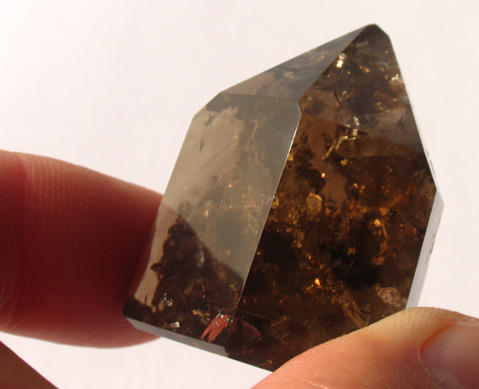 smoky quartz crystal with inclusions