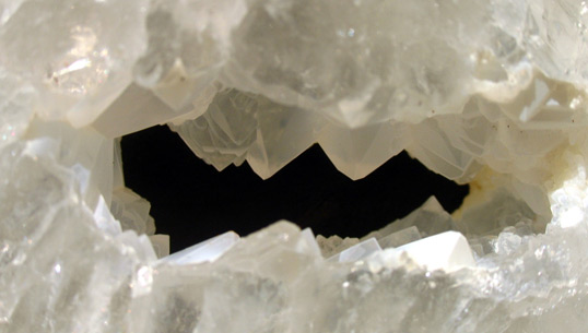 quartz geode slice with tourmaline crystals