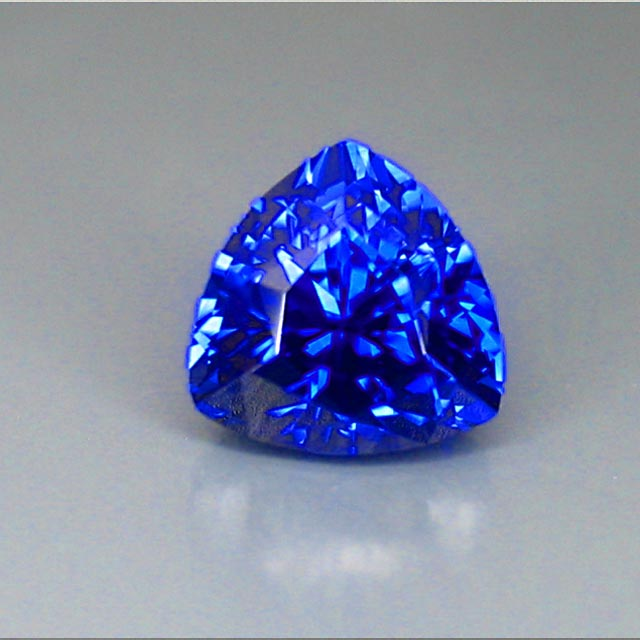 glowing blue sapphire trilliant